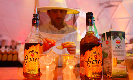 A bartender dressed as a beekeeper at the Jim Beam Honey launch party